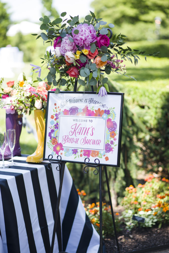 two of these fun umbrellas spilling over with bright colorful blooms greeted the guests as they entered the garden