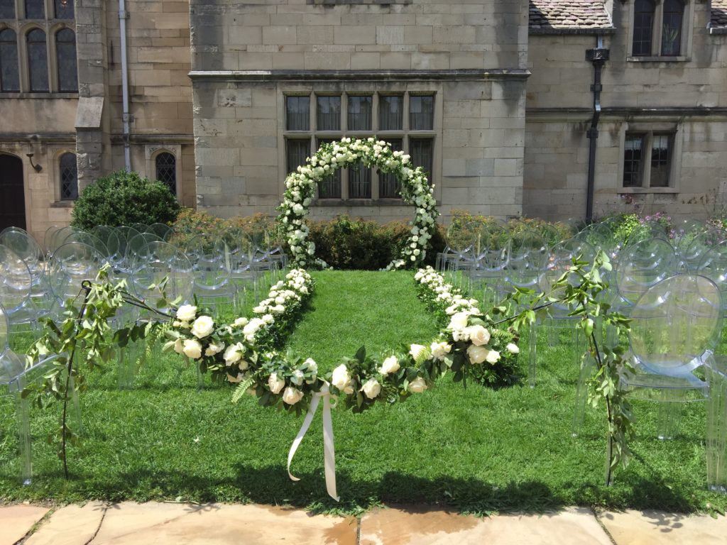 Mocha Rose custom design greenery white flowers moon arch outdoor ceremony Hartwood Acres mansion