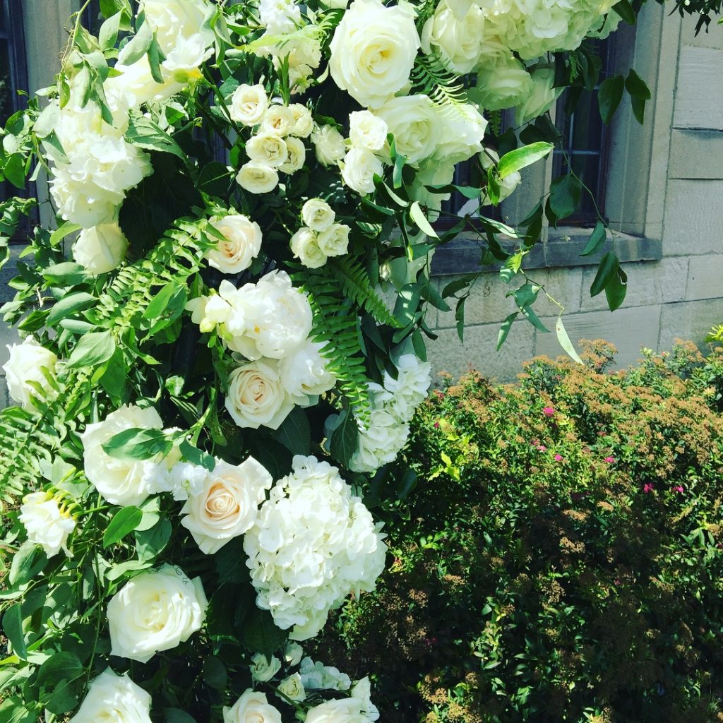 Mocha Rose custom design moon arch greenery white flowers detail photo outdoor ceremony Hartwood Acres