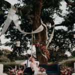 bride and groom outdoor July wedding vignette floral tree romantic newlyweds