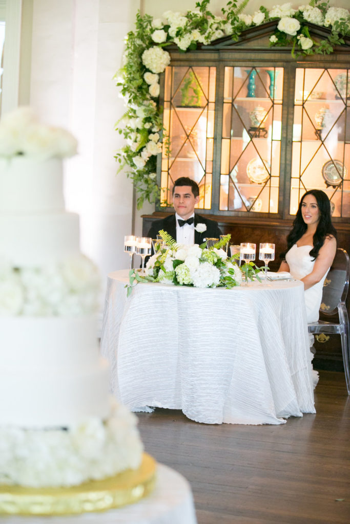 Fox Chapel Golf Club wedding reception sweetheart table white flowers greenery garland custom floral designs
