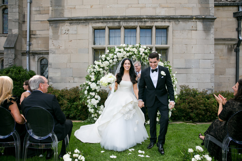 Hartwood Acres Mansion outdoor wedding ceremony couple walking up aisle just married