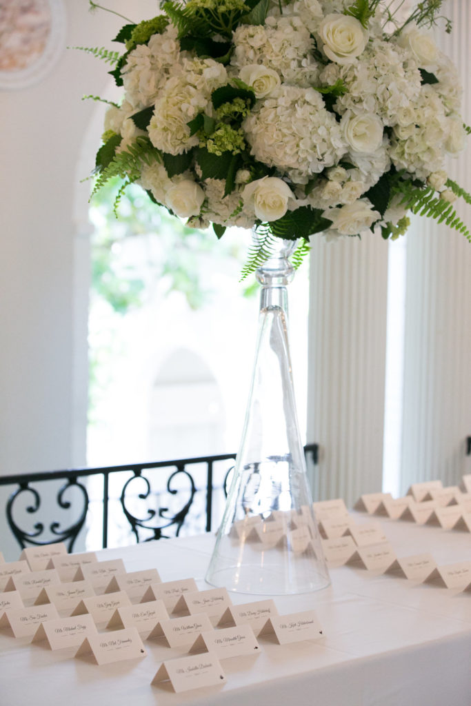 white flowers greenery escort card table centerpiece Fox Chapel Golf Club wedding