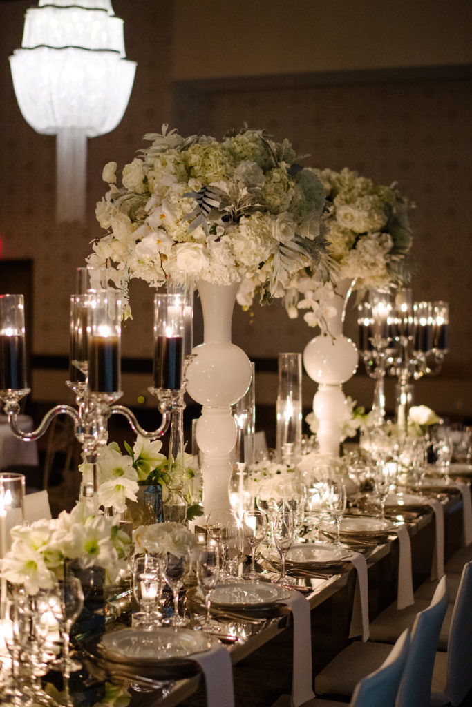 night time wedding reception Fairmont Pittsburgh ballroom head kings table reception decor statement flowers