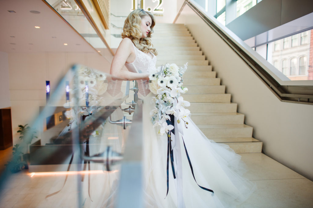 modern bride black white silver bridal bouquet Fairmont Hotel Pittsburgh stairs wedding photo Michael Will Photography
