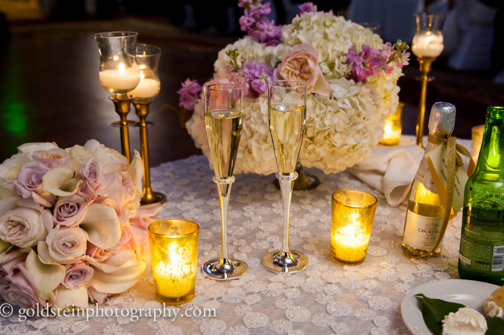 sweetheart table low centerpiece bridal bouquet wedding reception champagne flutes