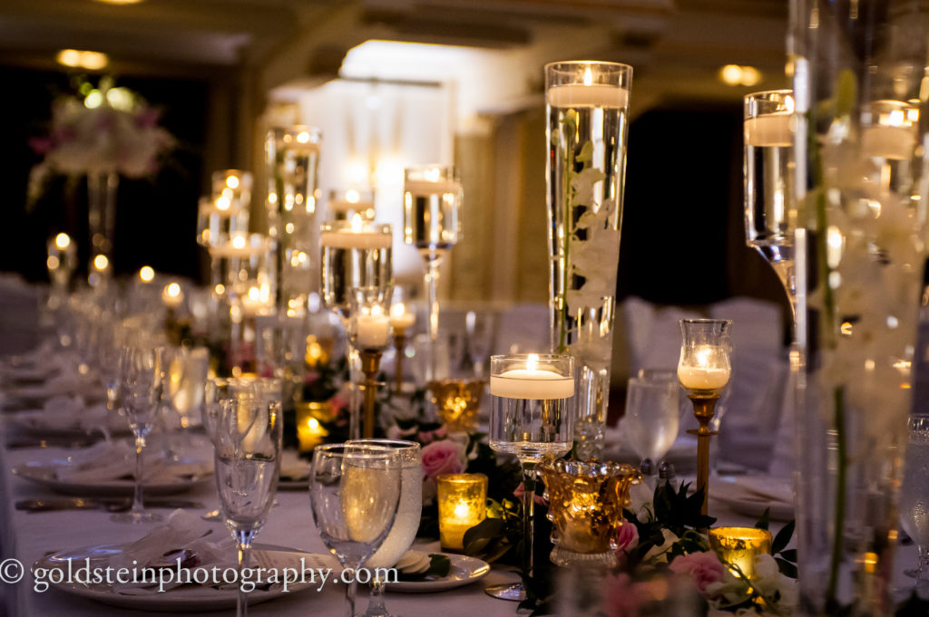 mixed heights candles table garland centerpiece wedding reception