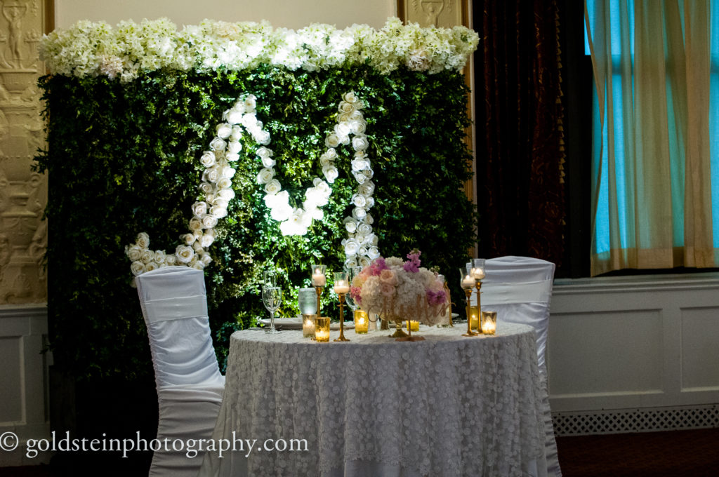 custom boxwood wall white rose monogram wedding reception sweetheart table