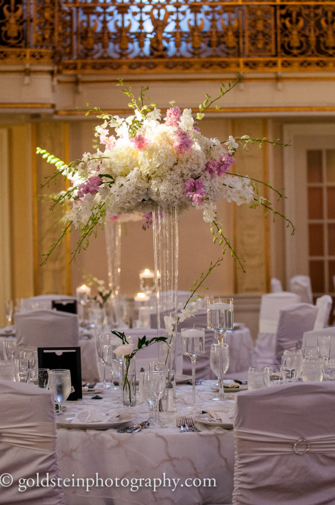 tall flowers guest table centerpiece white pink wedding