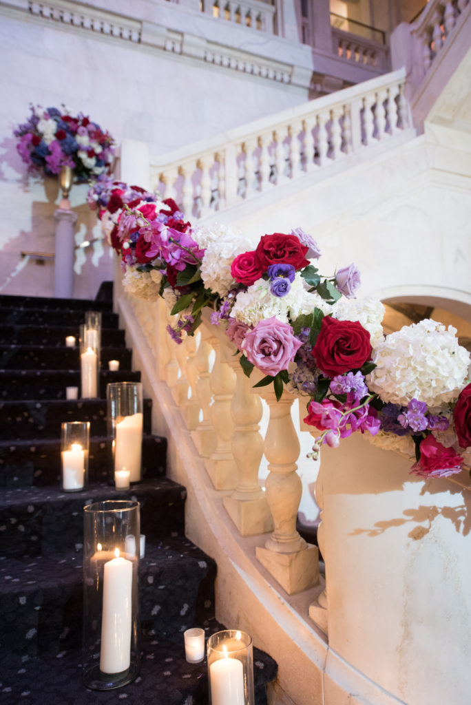 Renaissance Hotel grand staircase wedding ceremony railing flowers details candles